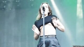 flashes her tits during a concert